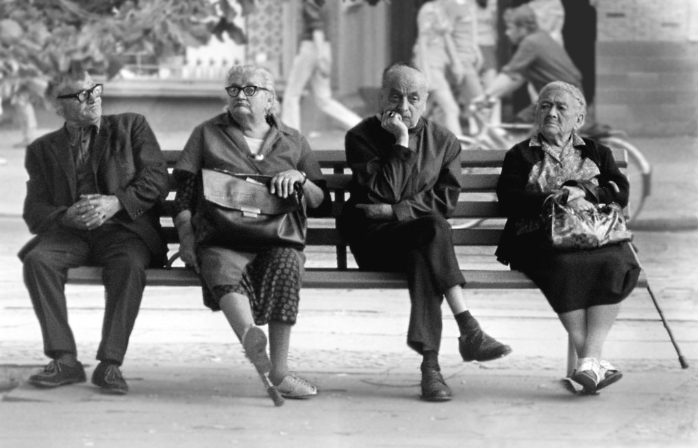 Older people sitting on a bench