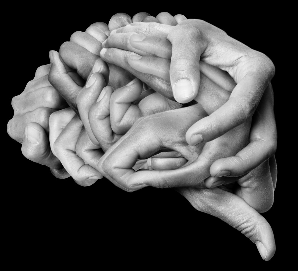 Symbolic image of brain made up of hands